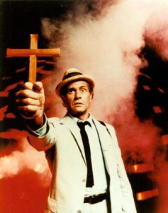 Actor holding cross from the Night Stalker