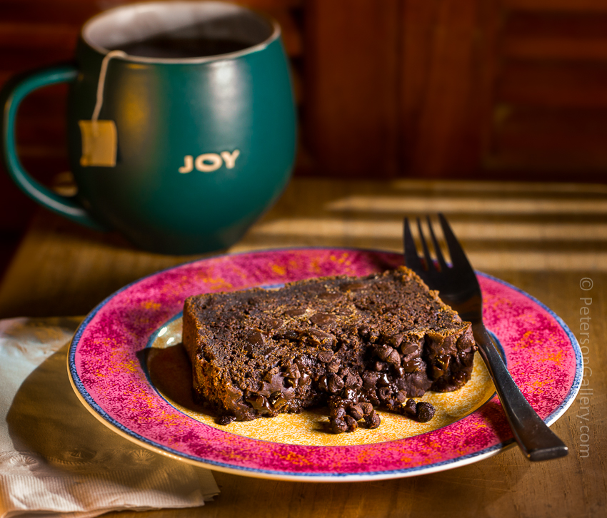 Slice of Chocolate Pumpkin Bread on Plate with Form and Cup of Hot Tea